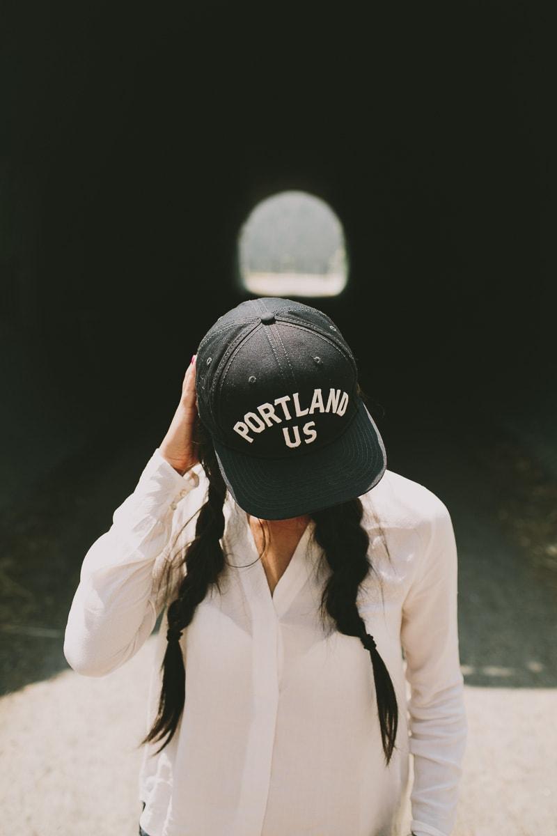 girl wearing Portland hat