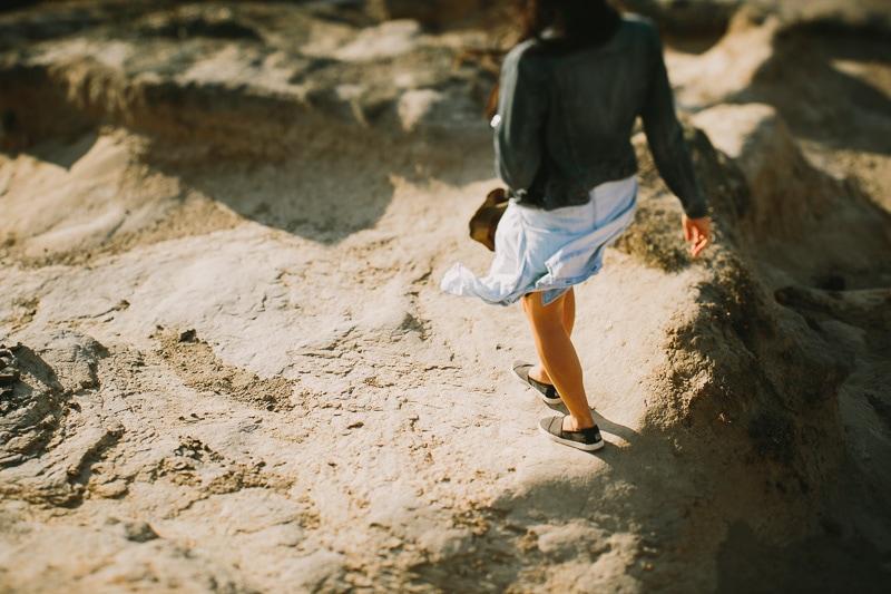 view of girls legs walking on rocks