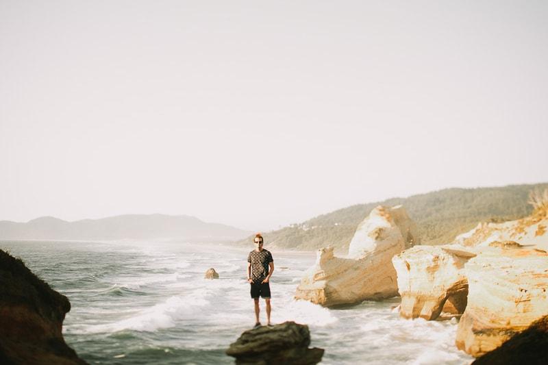 guy standing on rock