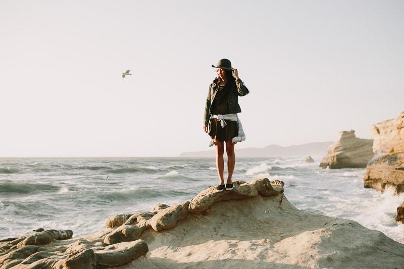 girl standing on rocks