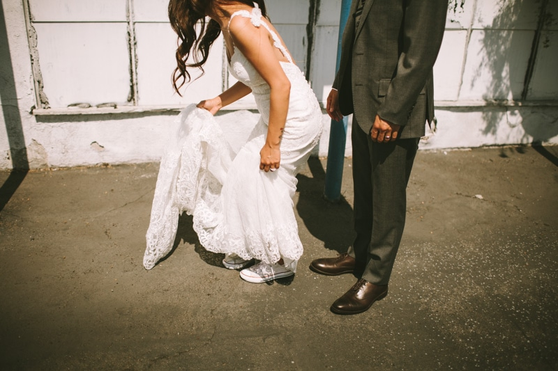 bride wearing converse shoes