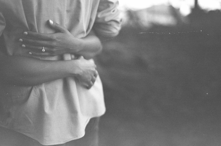 black + white of arms wrapped around