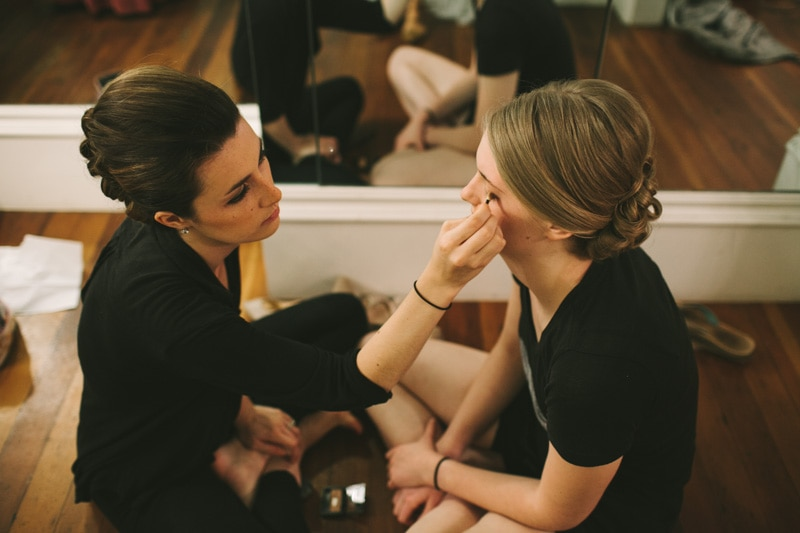 bridesmaids putting on makeup