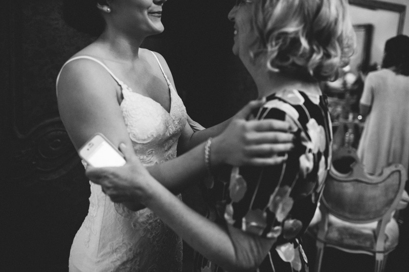 bride and mom embracing