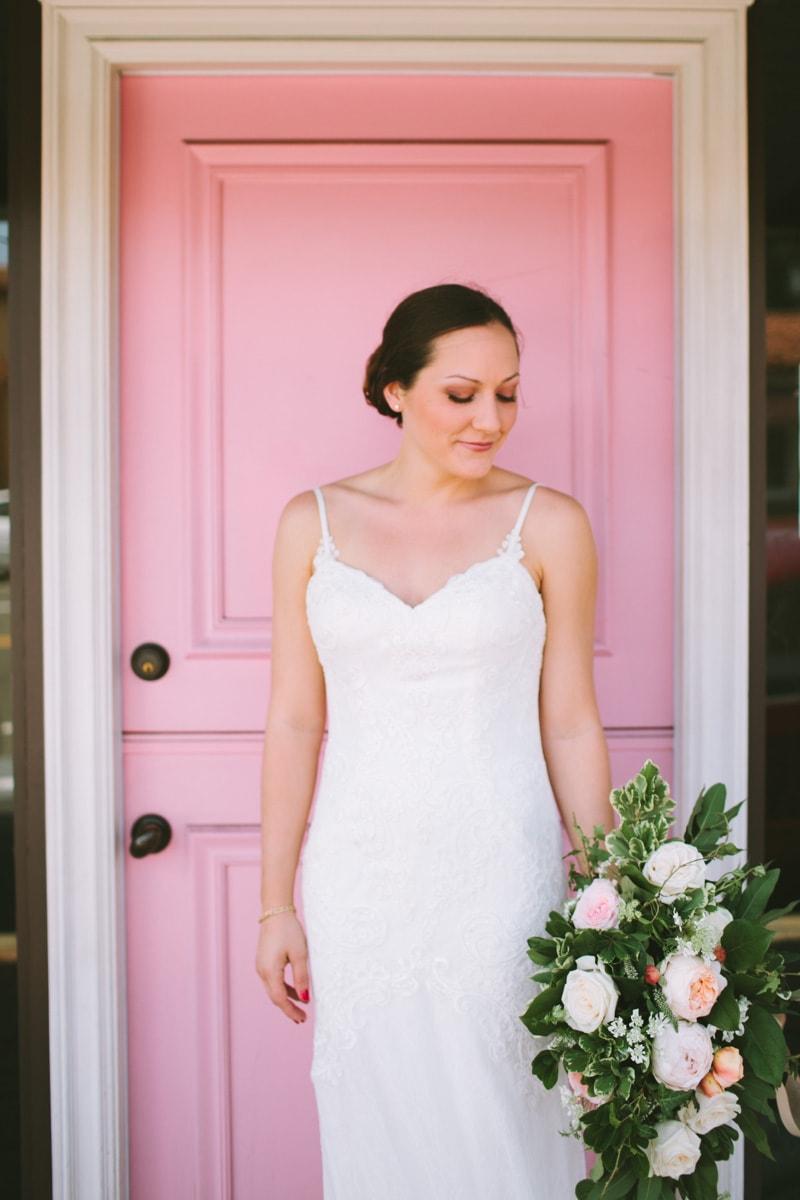 bride in front of pink door