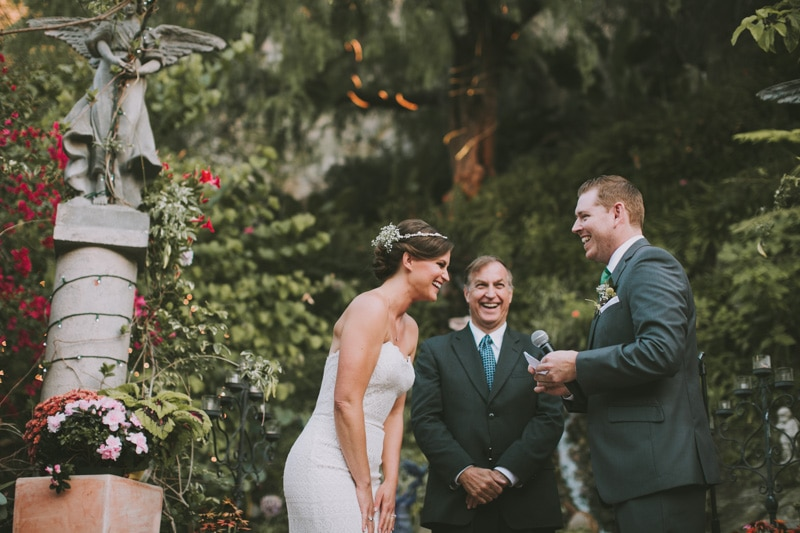 wedding ceremony surrounded by green plants