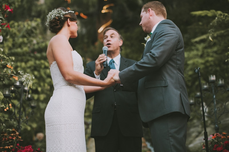 holding hands during ceremony