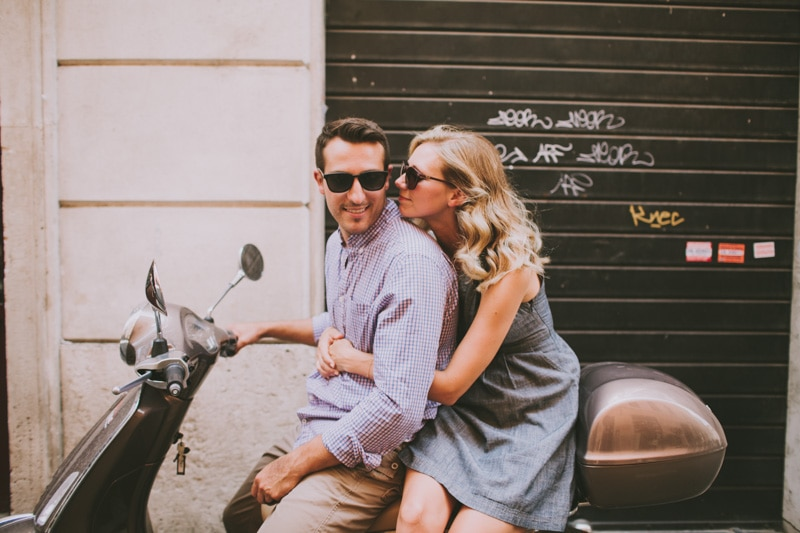 couple kissing on vespa
