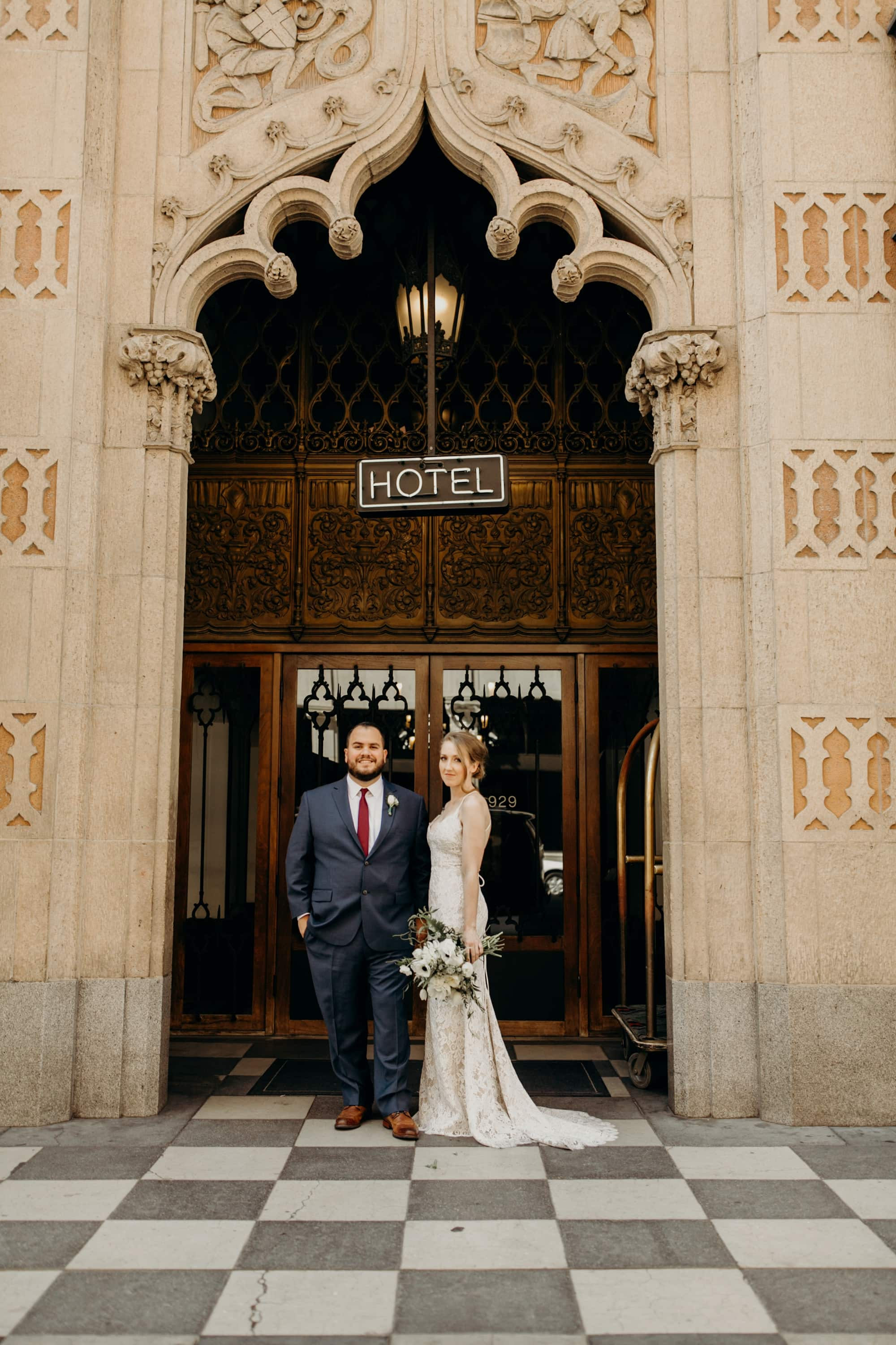 wedding couple standing in front of the ace hotel los angeles