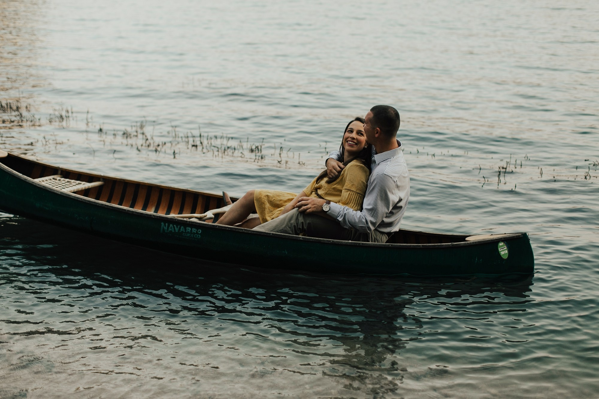 couple in a lake with navarro canoe