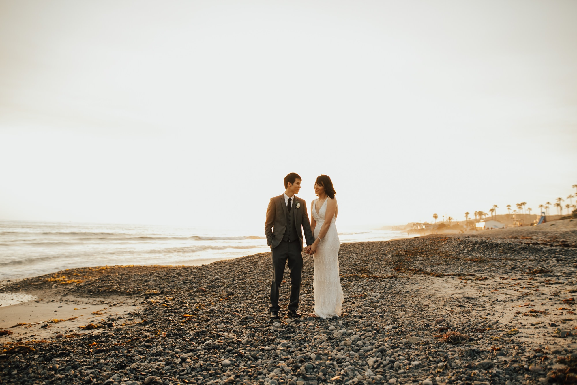 wedding portraits by the beach at sunset