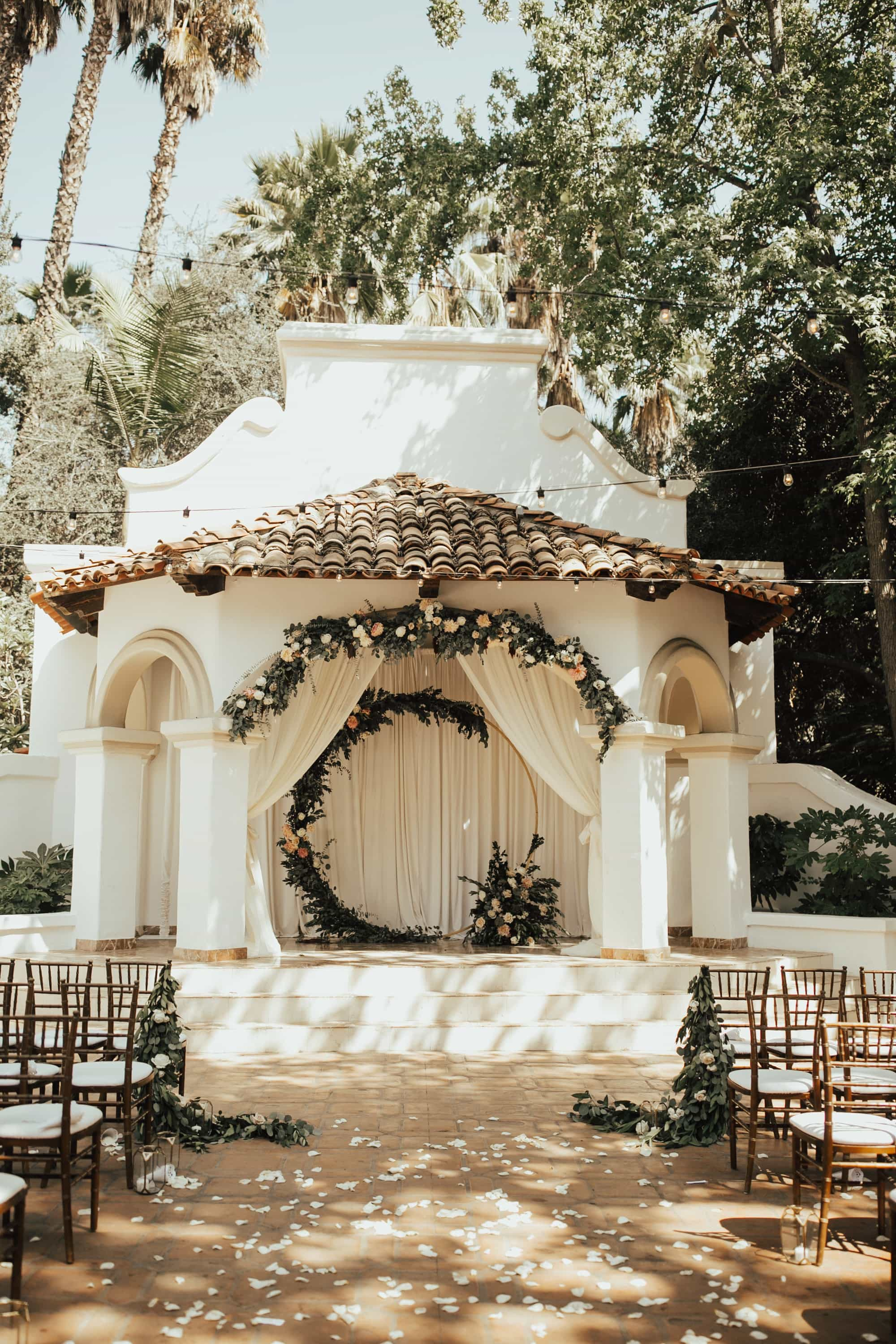 wedding ceremony setup at Rancho Las Lomas with two floral arches