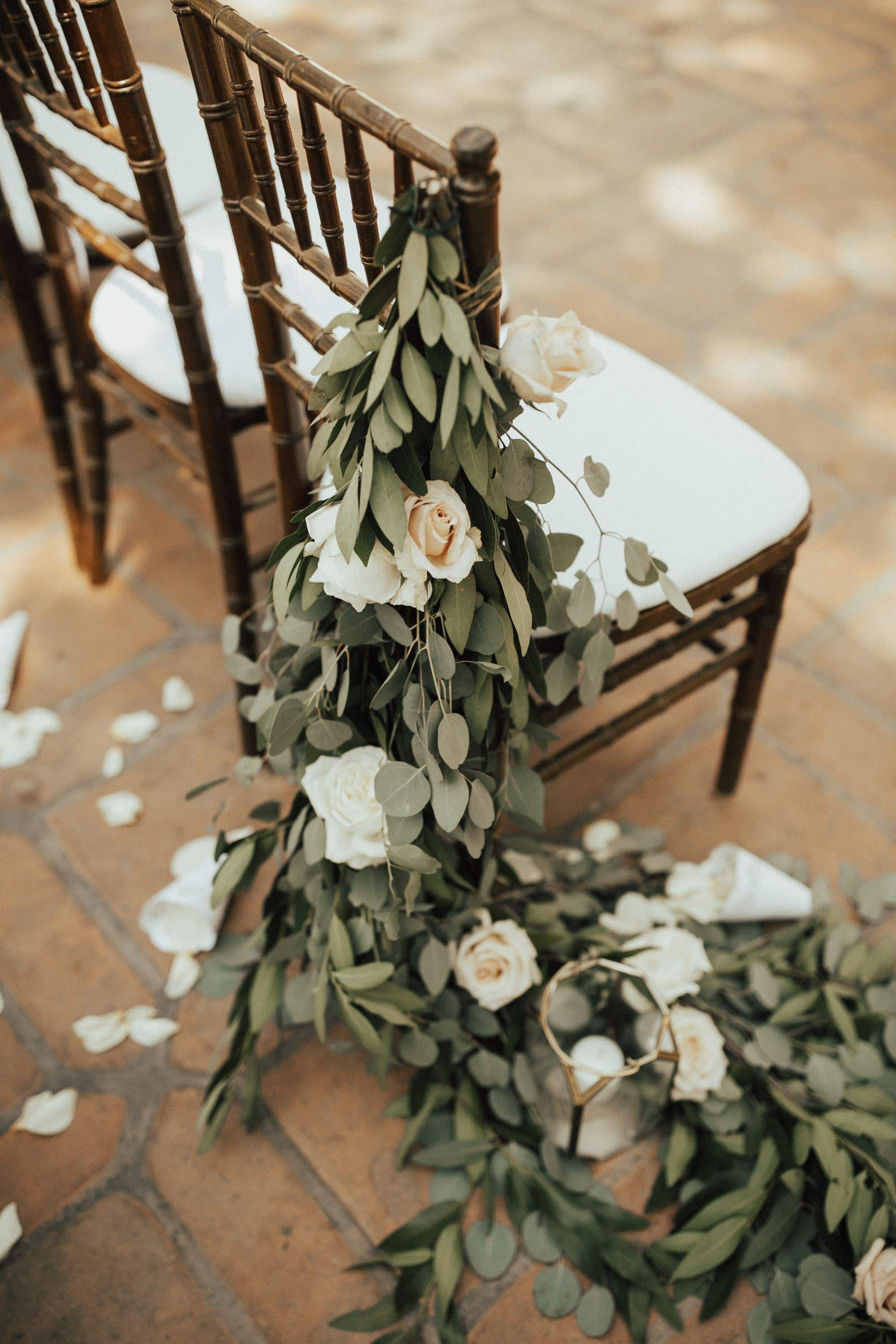 greenery hanging over chair for the wedding ceremony