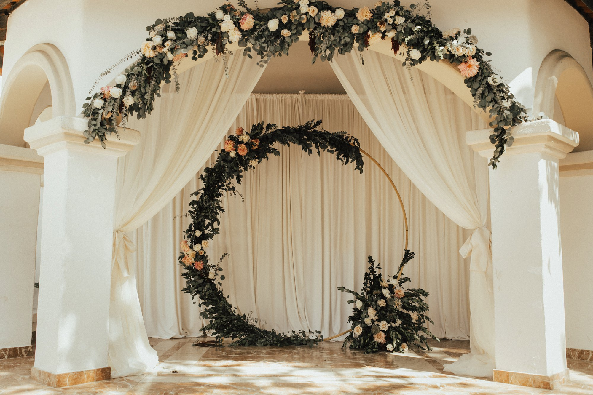 double floral arches for wedding ceremony