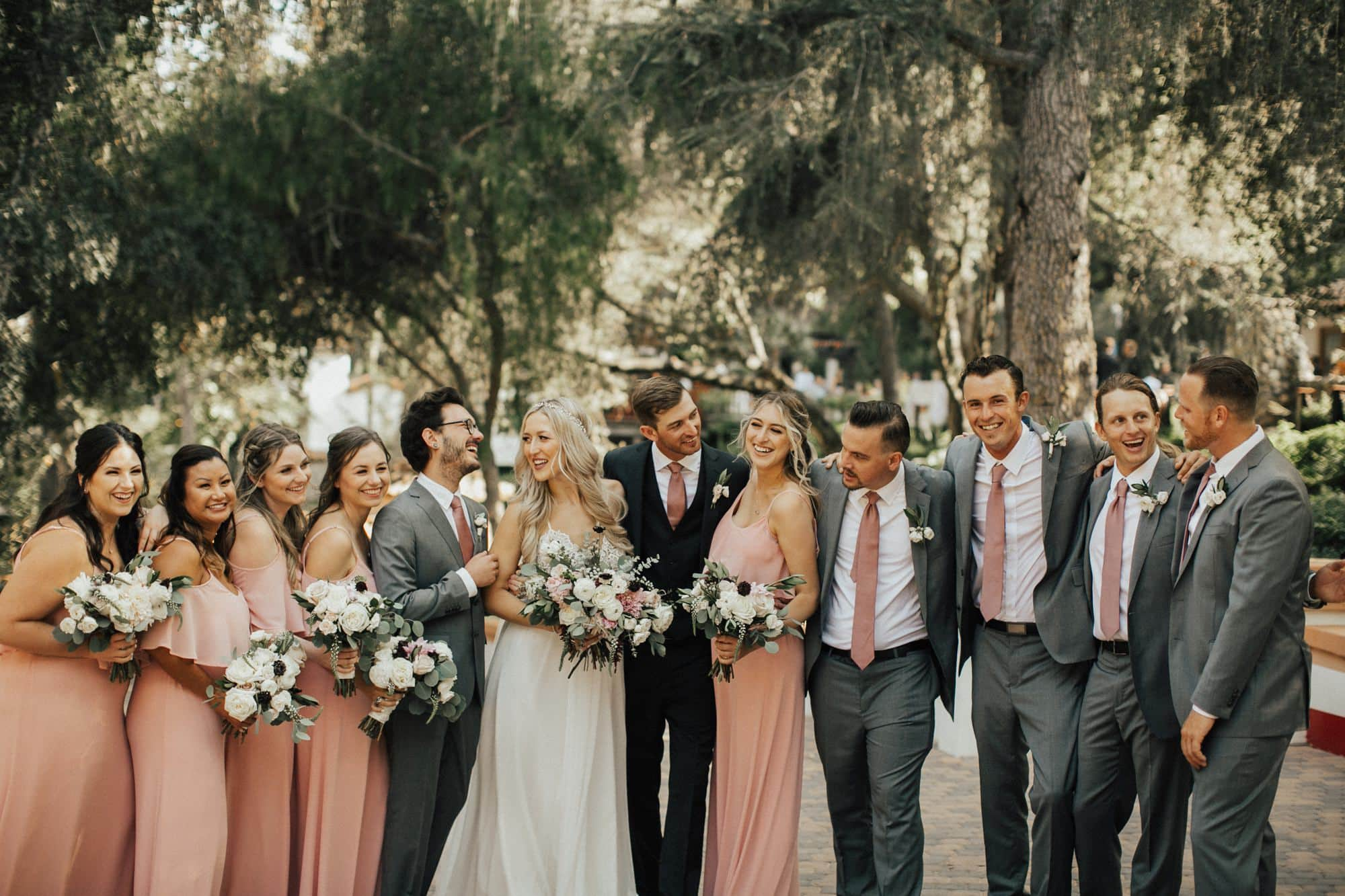 wedding party wearing pink and gray