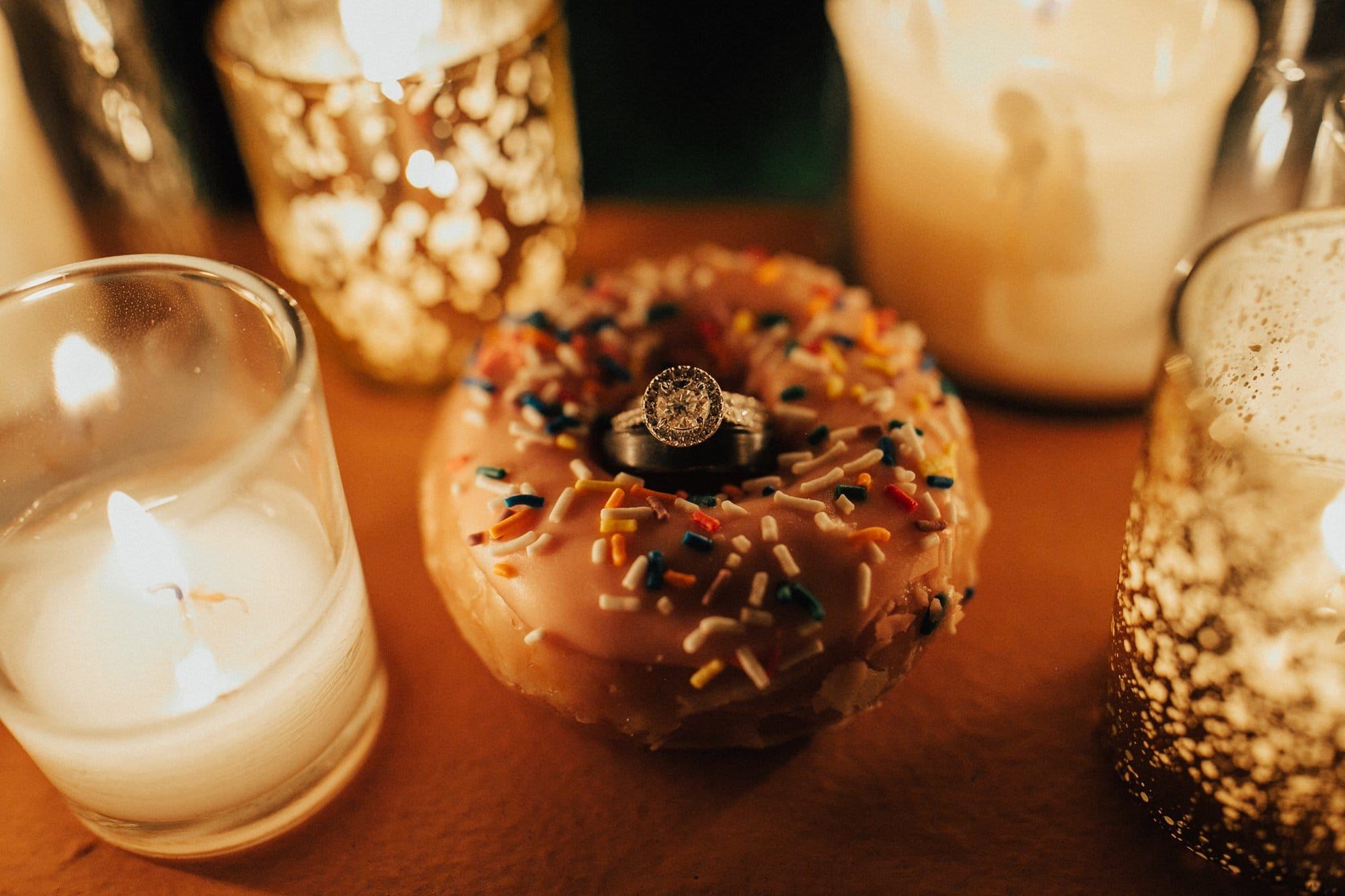 wedding ring shot with donut and candles