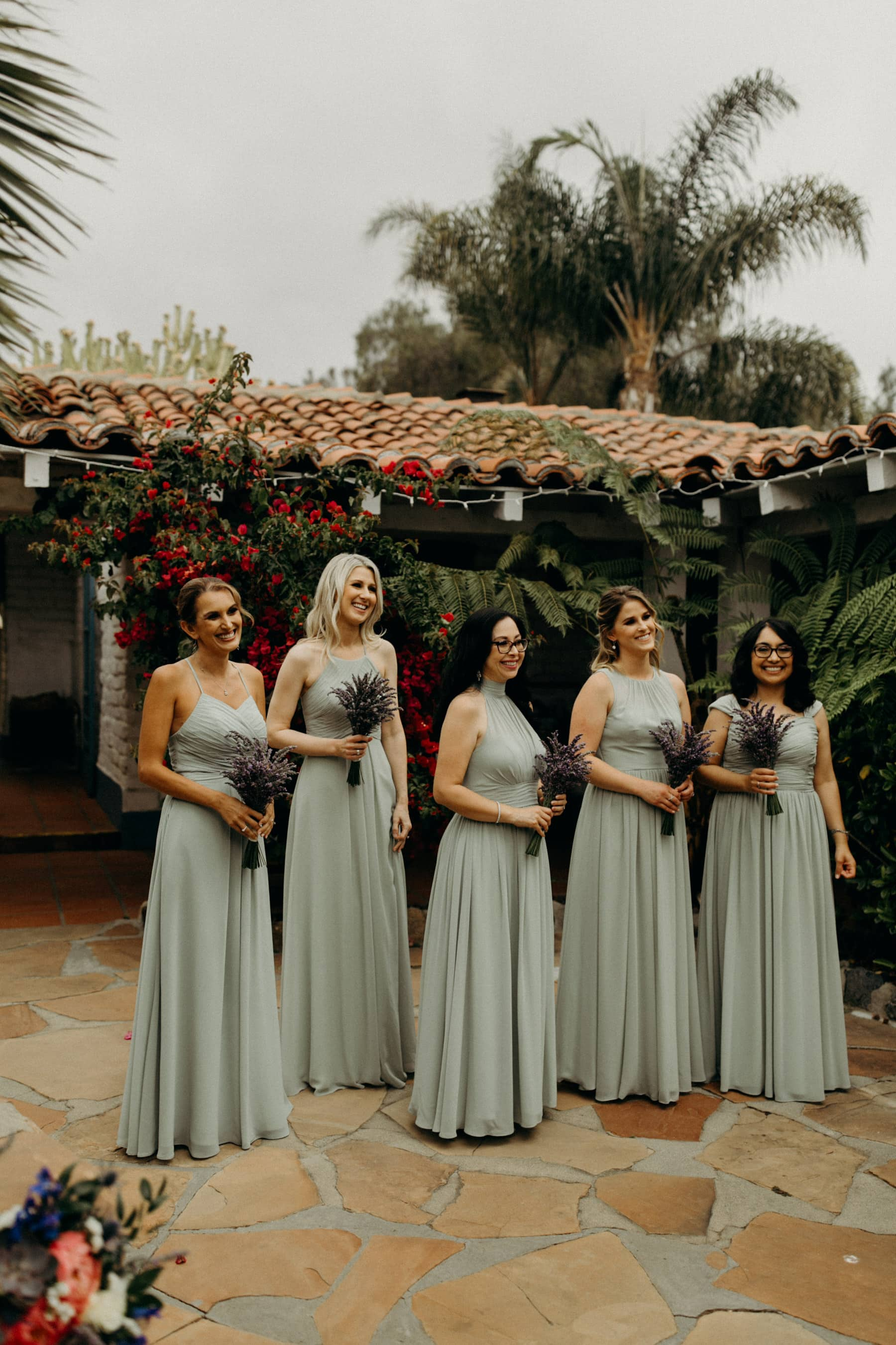 sage bridesmaids dresses with lavender bouquets