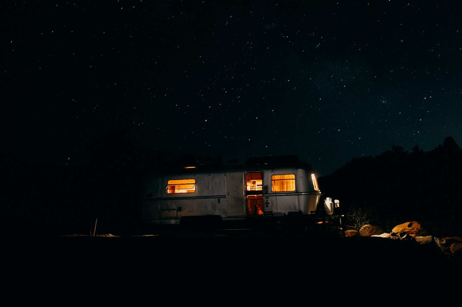 trailer at night with starry skies