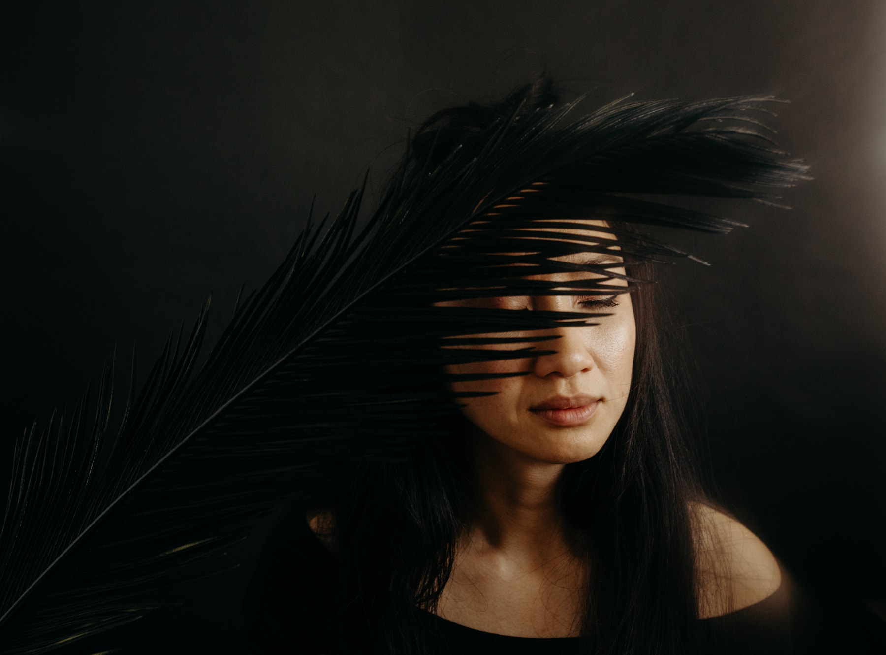 portrait with black palm leaf