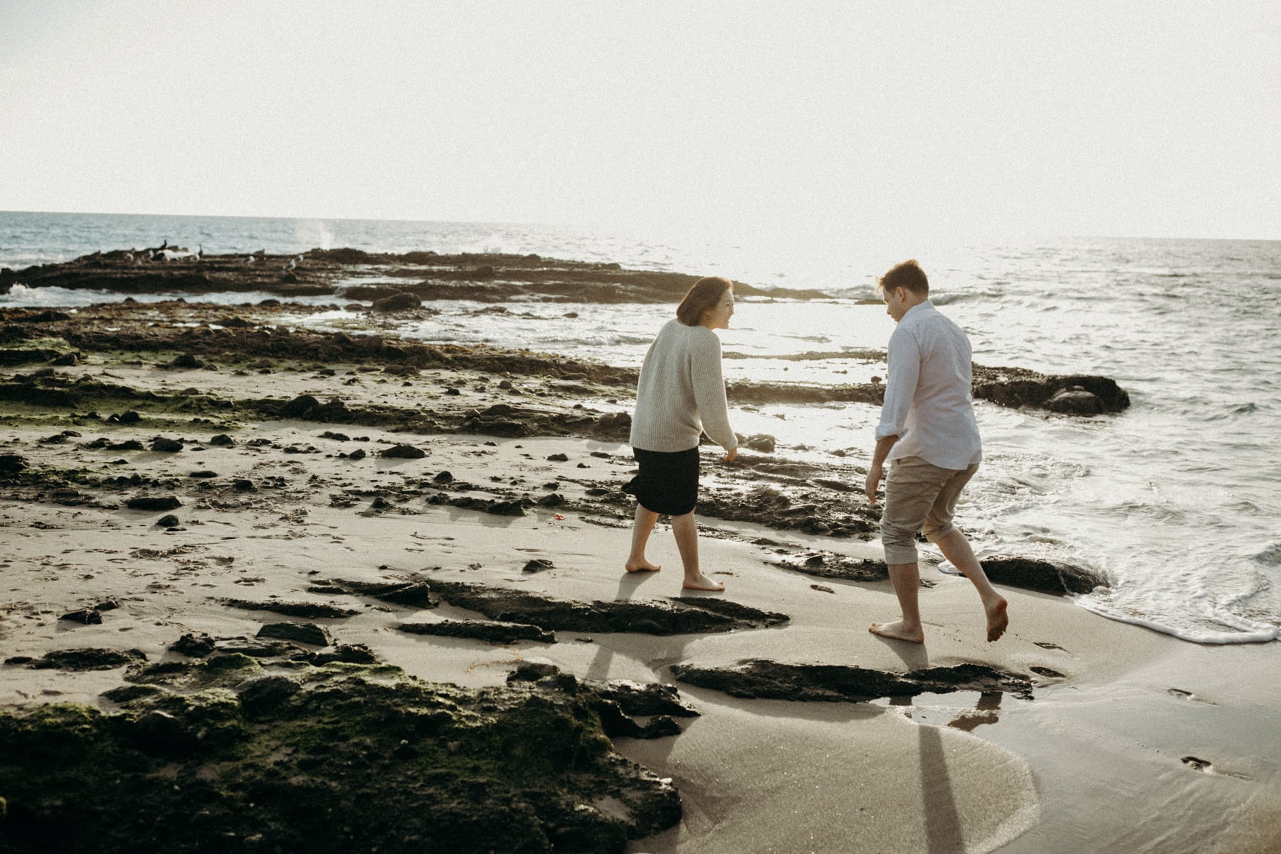 laguna beach engagement session as tide goes down